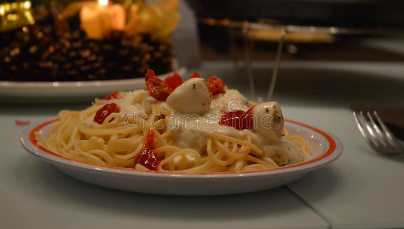 Spagetti. With cheese and tomatoes stock photo