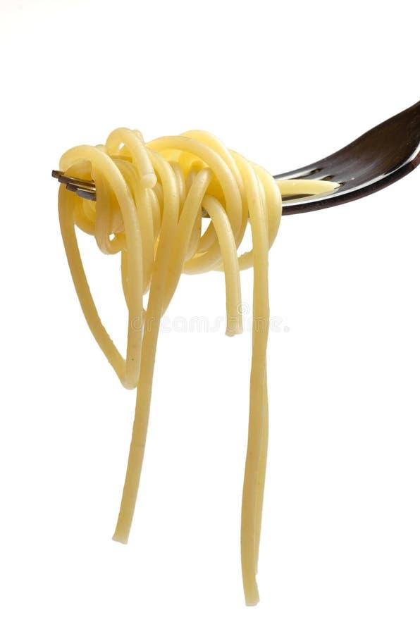 Spagetti och gaffel arkivfoton