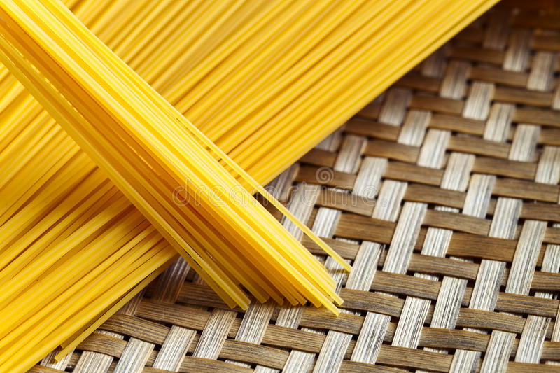 Spagetti. Uncooked spagetti in basket , focus on center stock image