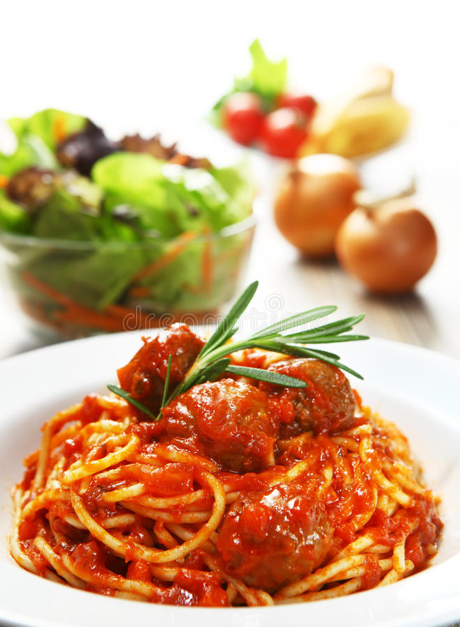 Spaghetti. Meat balls bolognese spaghetti with vegetables background royalty free stock photos
