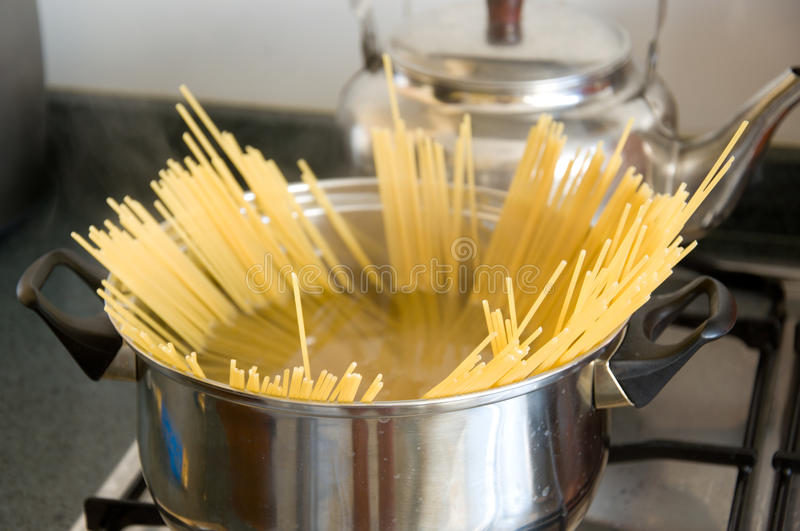 Spaghetti. Close up of boiling spaghetti in a pot stock photography
