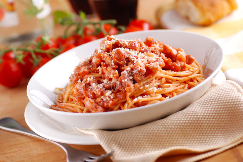 Spaghetti Amatriciana in the white plate stock photography
