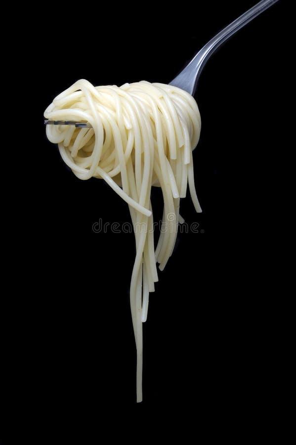 Spaghetti au-dessus de noir image libre de droits