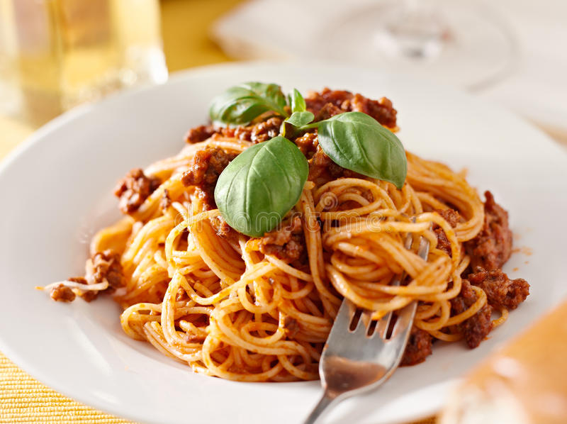 Spaghetti With Basil Garnish In Meat Sauce Closeup Royalty Free Stock Image