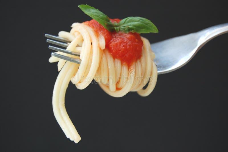 Spaghetti and basil leaf royalty free stock image