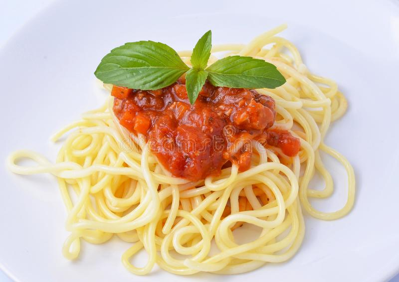 Spaghetti Bolognese with cheese and basil royalty free stock photos