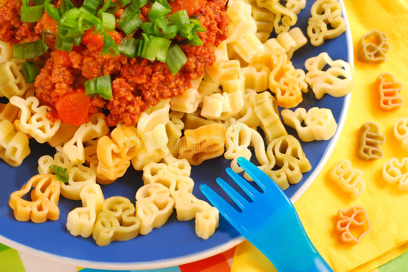 Spaghetti bolognese for child stock photography