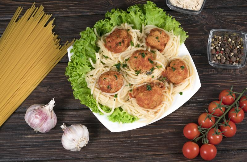 Spaghetti bolognese pasta with tomato sauce, vegetables and minced meat - homemade healthy Italian pasta on a rustic wooden stock photo