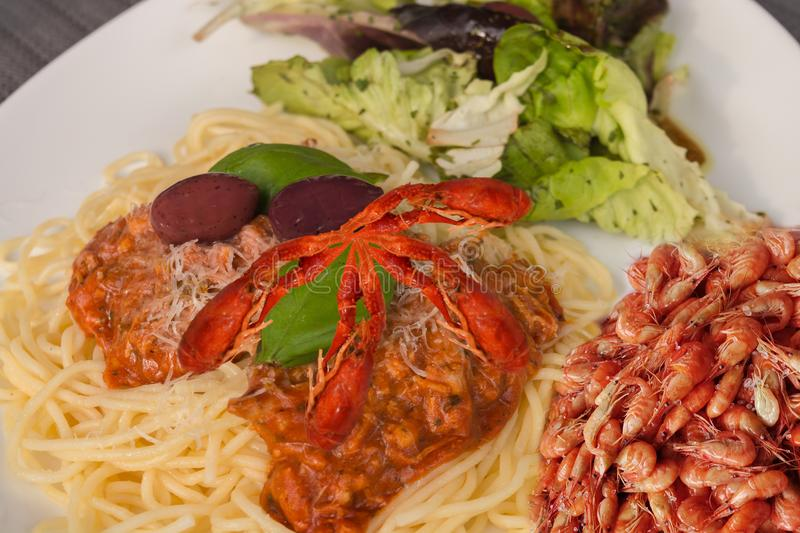 Spaghetti Bolognese with prawns and gambas stock images