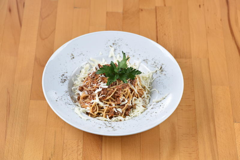Spaghetti Bolognese. Served with cheese royalty free stock photo