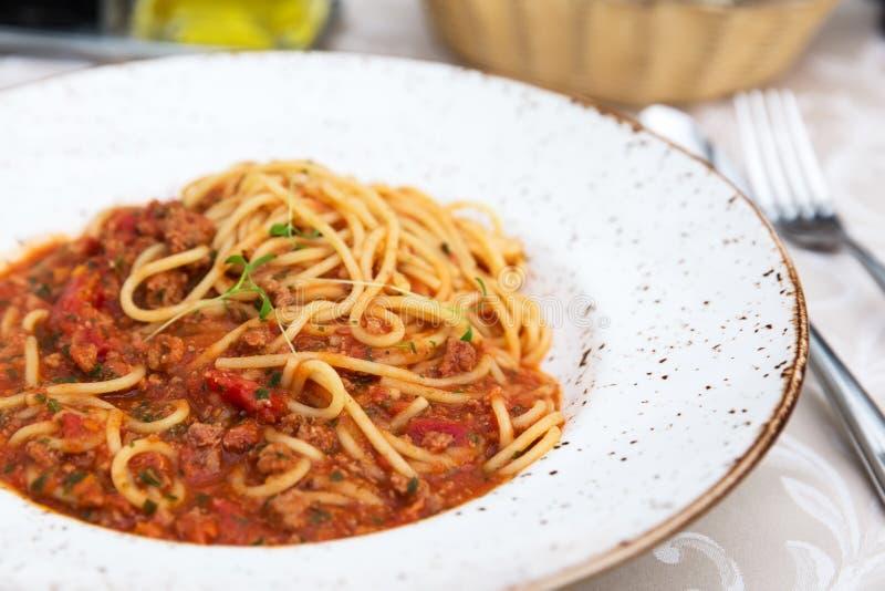 Spaghetti bolognese on a white plate stock photo