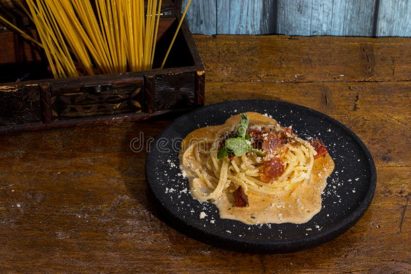 Spaghetti carbonara in black term. Spaghetti carbonara with black term royalty free stock photography