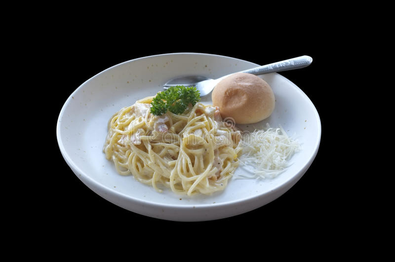 Spaghetti Carbonara with bun and French fries stock photos