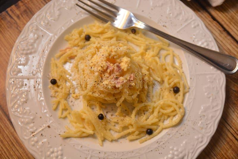 Spaghetti carbonara italian classic dish gourmet food whit eggs chees ham. On table italian cuisine royalty free stock photos