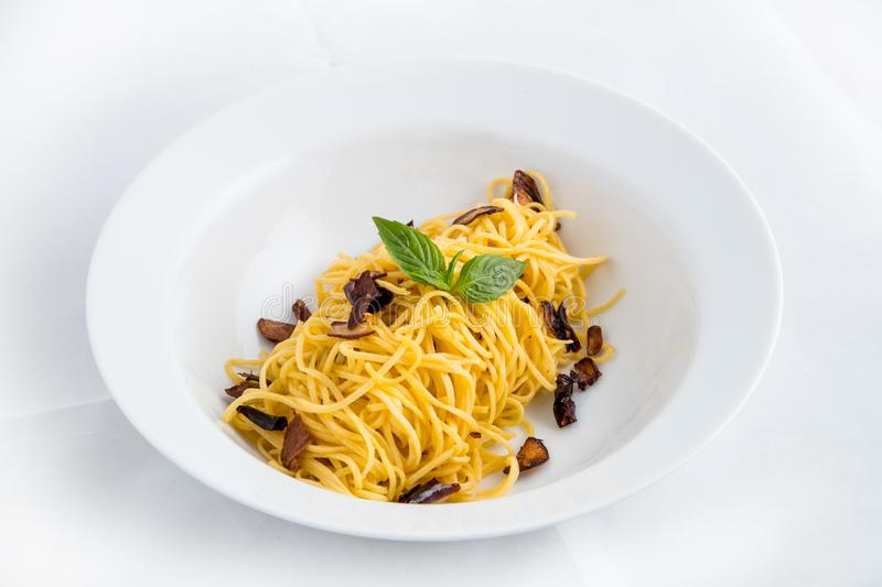 Spaghetti carbonara, pasta noodles on white background stock photos