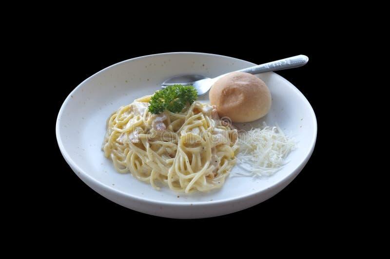 Spaghetti Carbonara z babeczką i francuzów dłoniakami zdjęcia stock