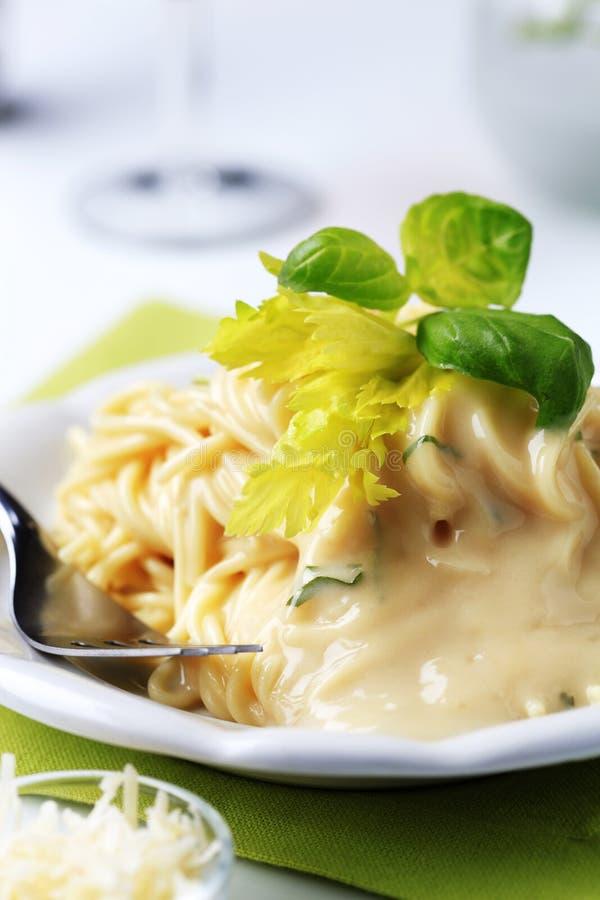 Spaghetti and creamy sauce stock photography