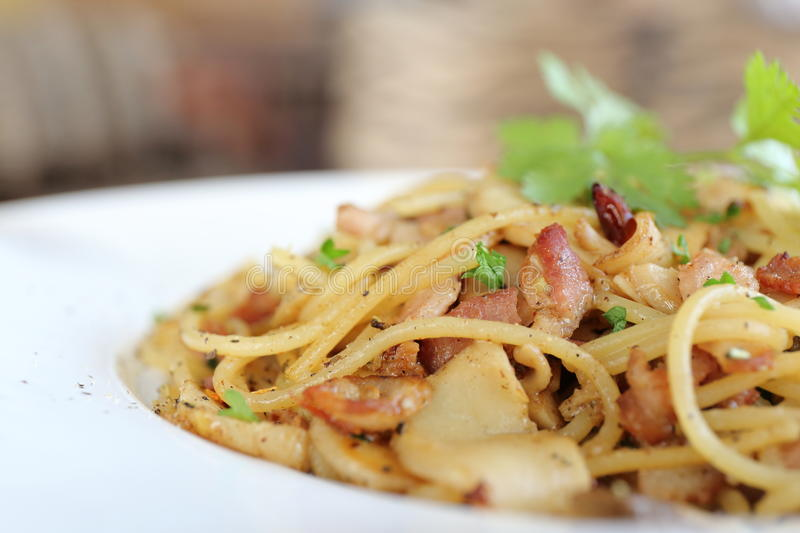 Spaghetti with dried chilli and bacon. In close up stock images
