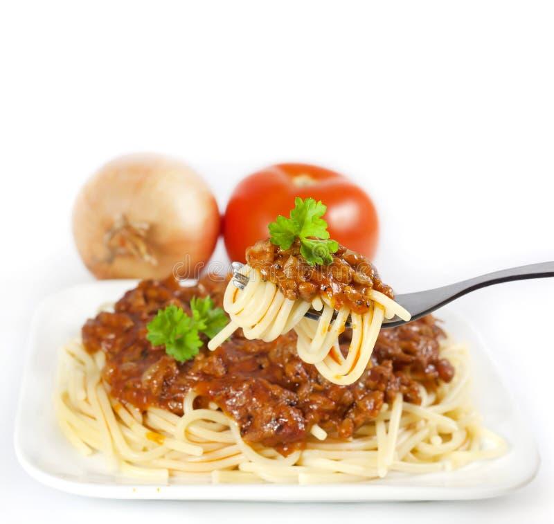 Spaghetti en ingrediënten stock afbeelding