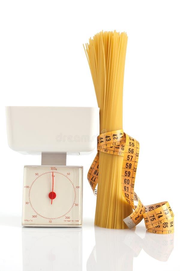 Spaghetti et échelle photos libres de droits