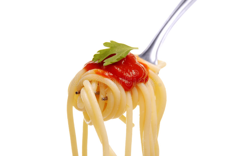 Spaghetti on a fork. Spaghetti with tomato sauce on a fork royalty free stock photography