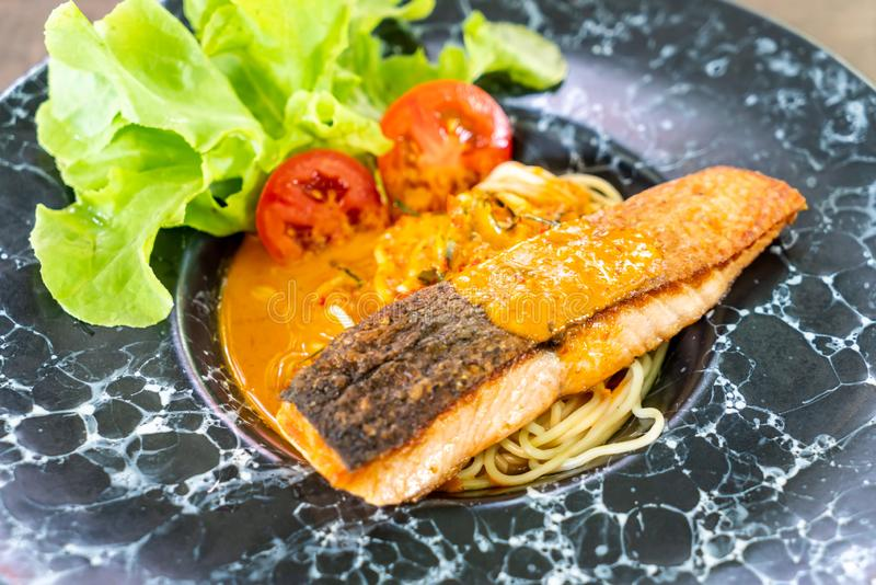 spaghetti with fried salmon royalty free stock photos