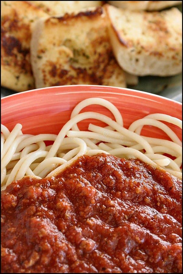 Spaghetti and garlic bread. Combo stock image