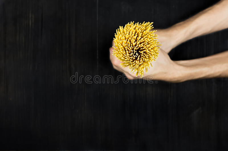 Spaghetti in hands royalty free stock photo