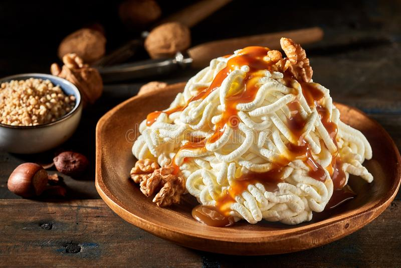 Spaghetti ice cream dessert with walnut sauce stock photography