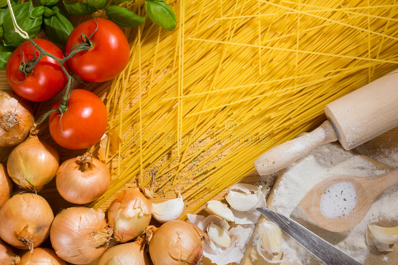 Spaghetti and ingredients stock images