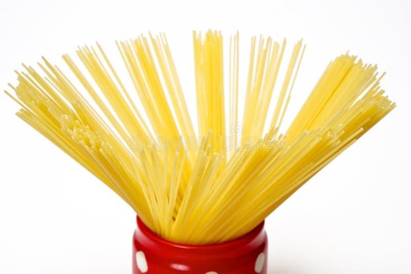 Spaghetti inside a red jar closeup