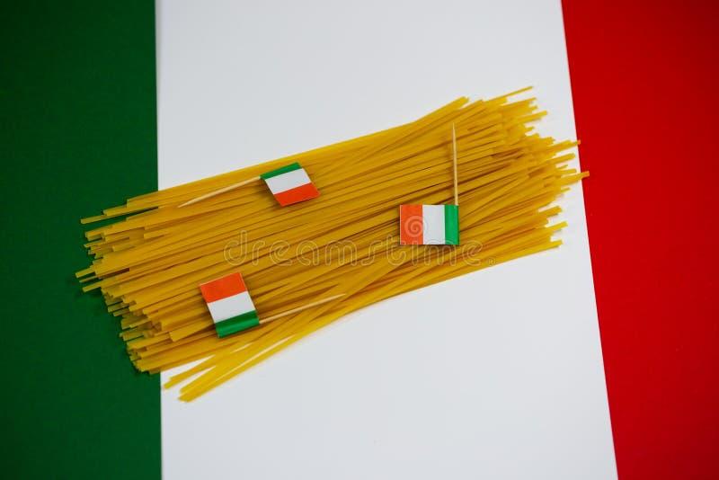 Spaghetti on italian flag, background. Food background royalty free stock photo