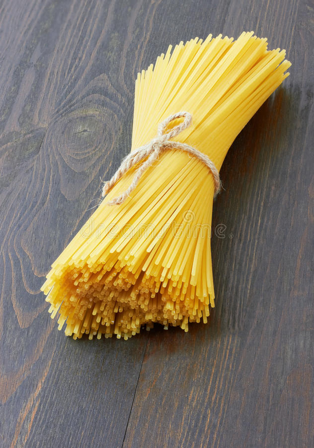 Spaghetti italian pasta on wood royalty free stock photography