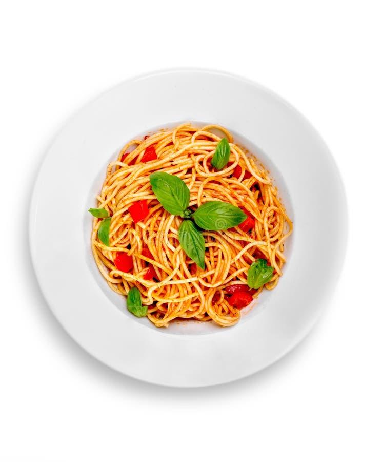 Spaghetti met tomatensaus en bestrooid met stock afbeeldingen