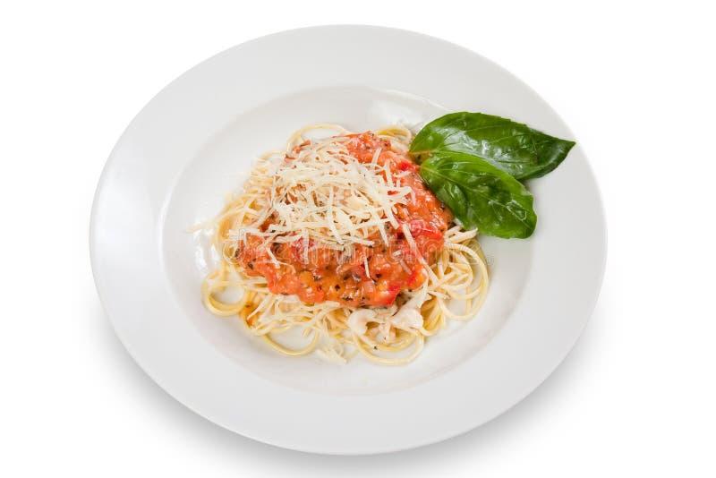Spaghetti met tomatensaus en kaas stock afbeelding
