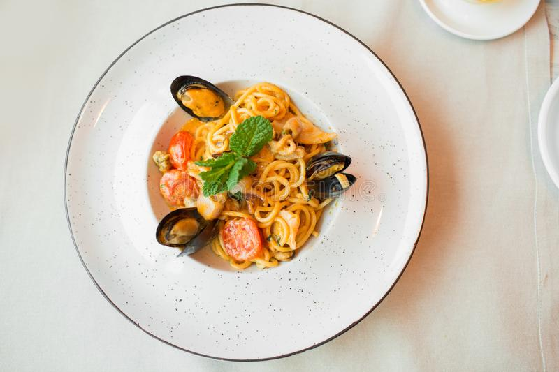 Spaghetti with mussels seafood. Soba noodles with shrimps and vegetables. Asian food. Pasta with seafood in tomato sauce. stock images