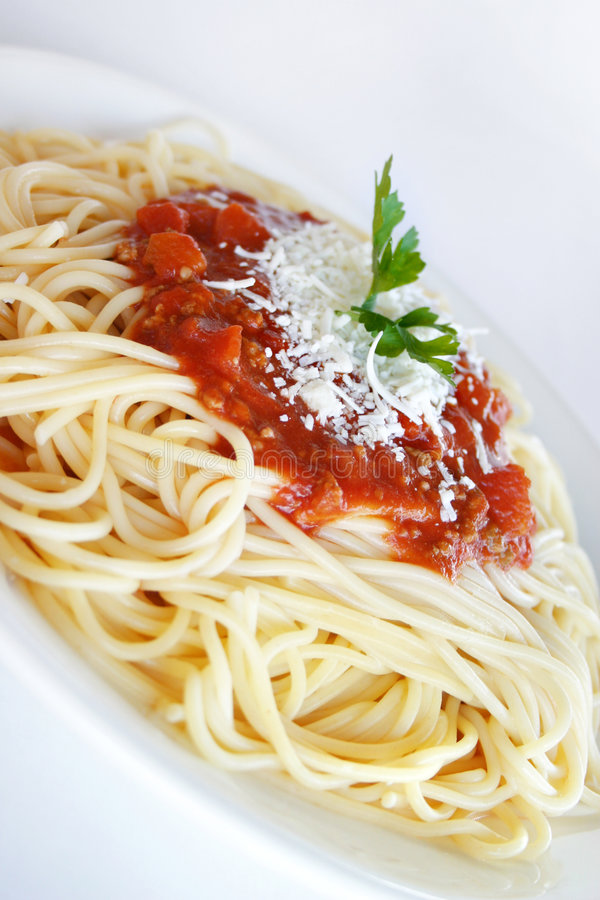 Spaghetti Napolitana. Closeup of a plate with spaghetti with tomato sauce and cheese