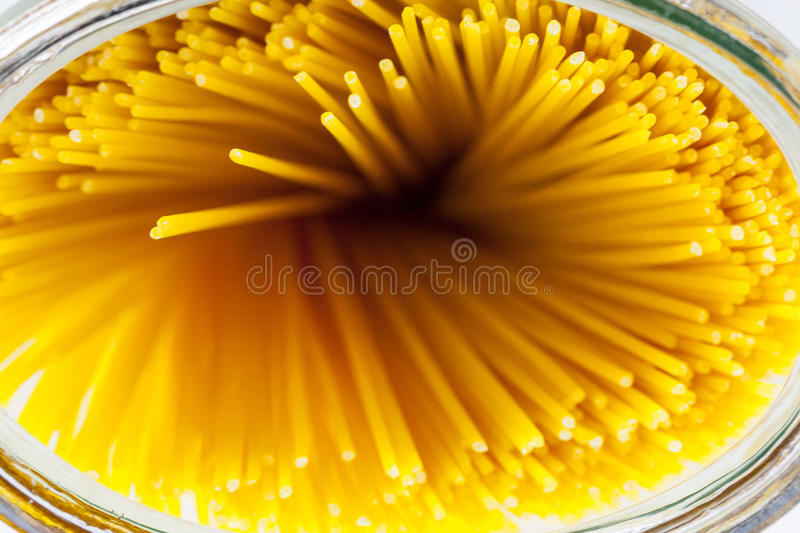 Spaghetti noodles in jar royalty free stock photography