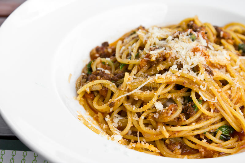 Spaghetti noodles with meat sauce. On white plate stock photo