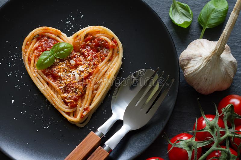 Spaghetti pasta heart love italian food diet abstract concept on black background royalty free stock photo