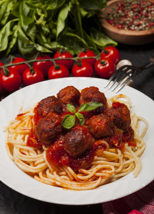 Spaghetti pasta with meatballs and tomato sauce stock image