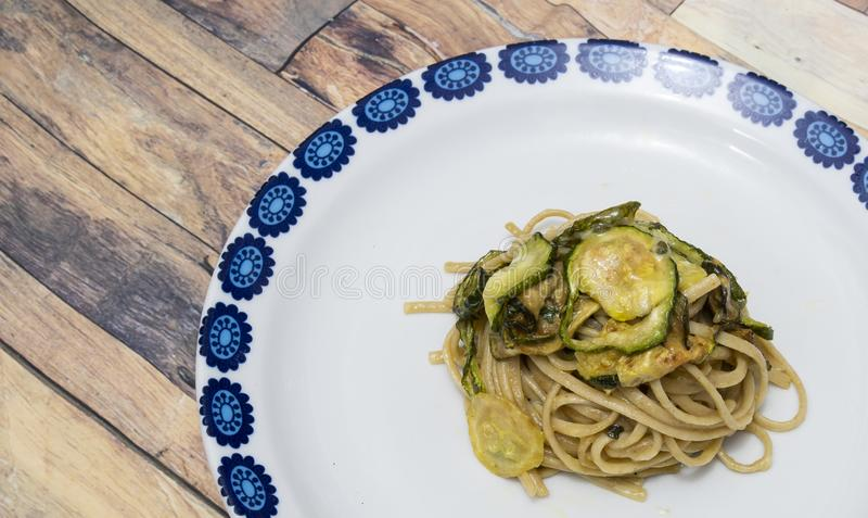 Spaghetti pasta with provolone and zucchini royalty free stock photography