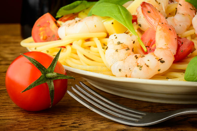 Spaghetti pasta with shrimps stock images