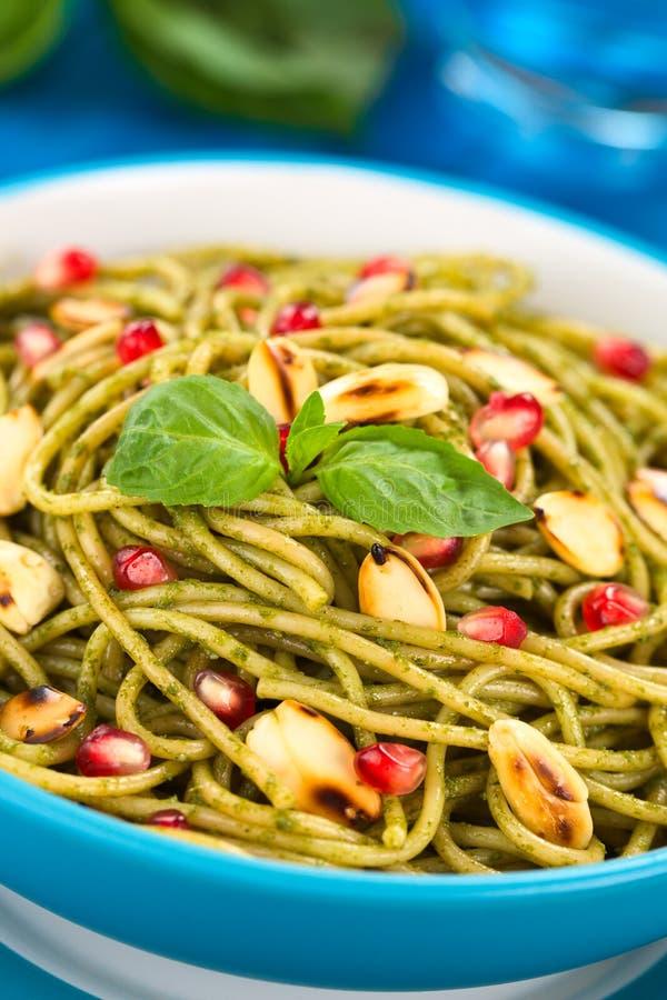 Spaghetti with Pesto, Almond and Pomegranate stock photography