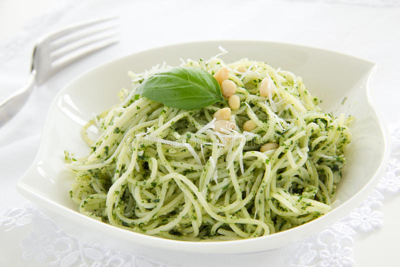 Spaghetti. Spaghetti with pesto sauce royalty free stock photography