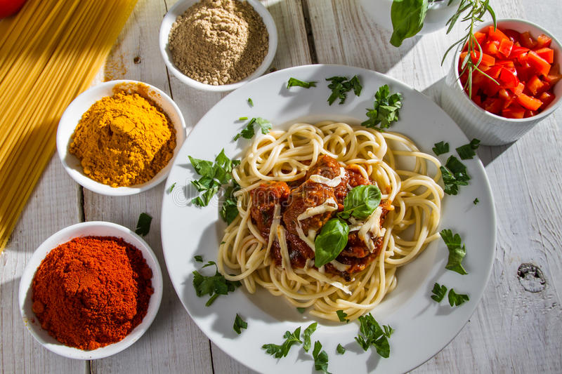 Spaghetti on a plate served with vegetables royalty free stock photos