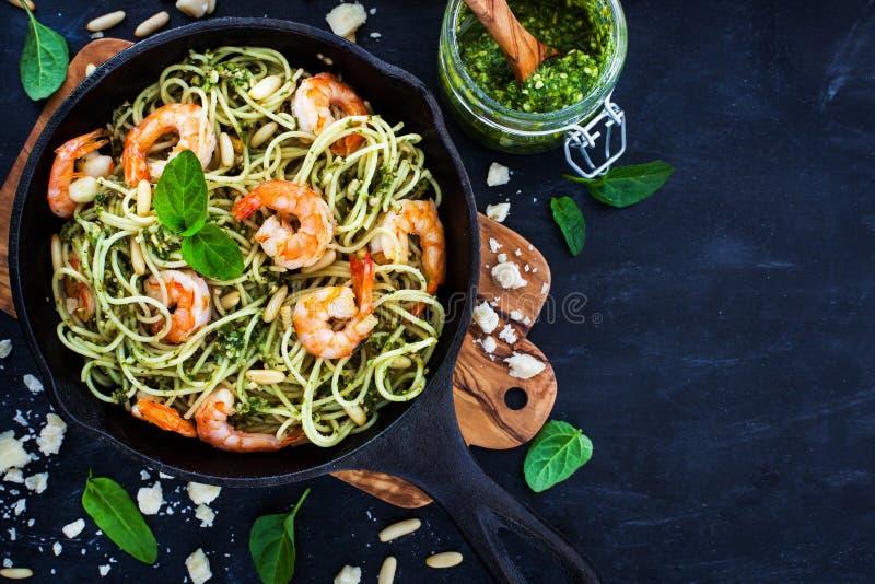 Spaghetti with prawns and homemade pesto sauce stock photography