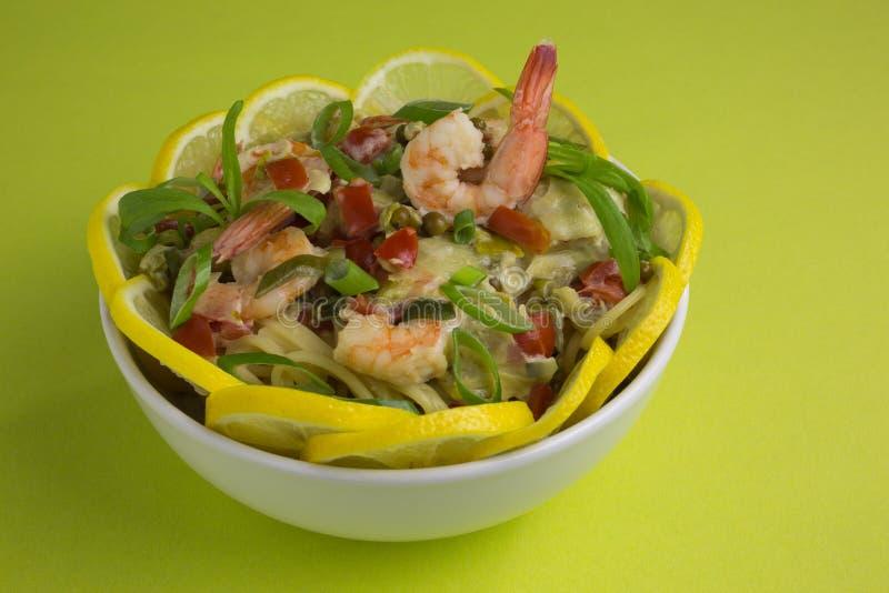 Spaghetti with prawns and lemon stock photos