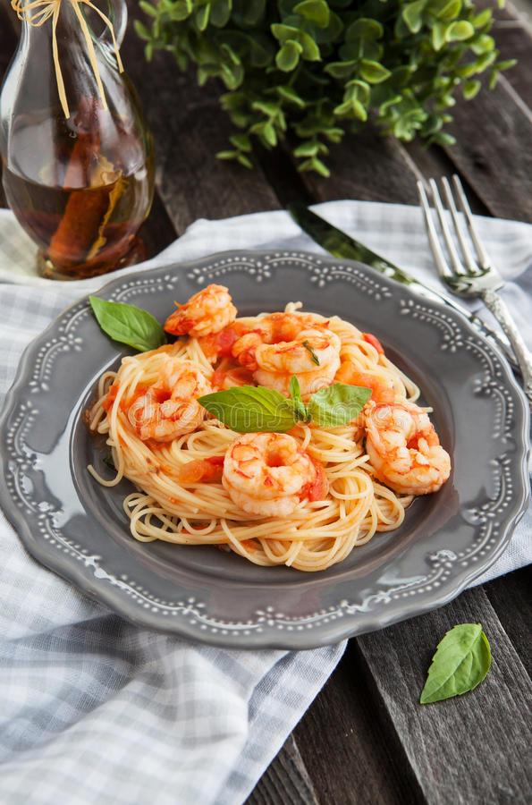 Spaghetti with prawns and tomatoes stock photo