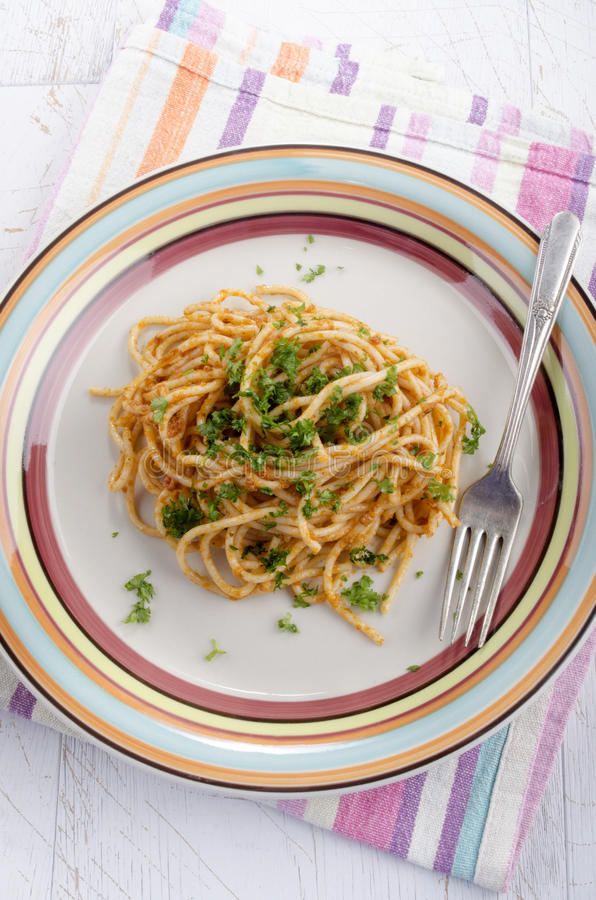 Download Spaghetti With Red Pesto And Parsley Stock Photo - Image of pesto, food: 39507350